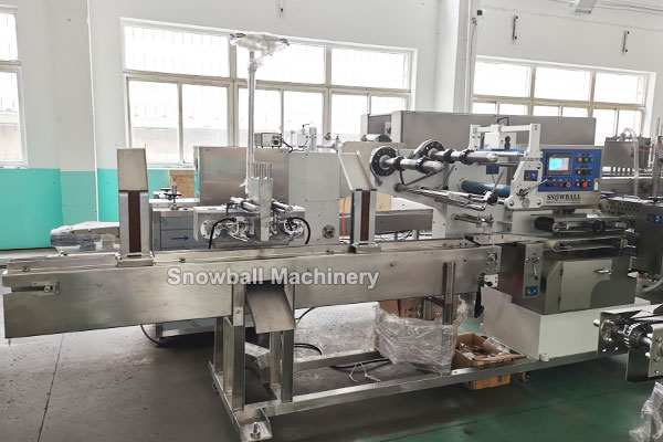Ice cream sandwich making and packing automatic machine